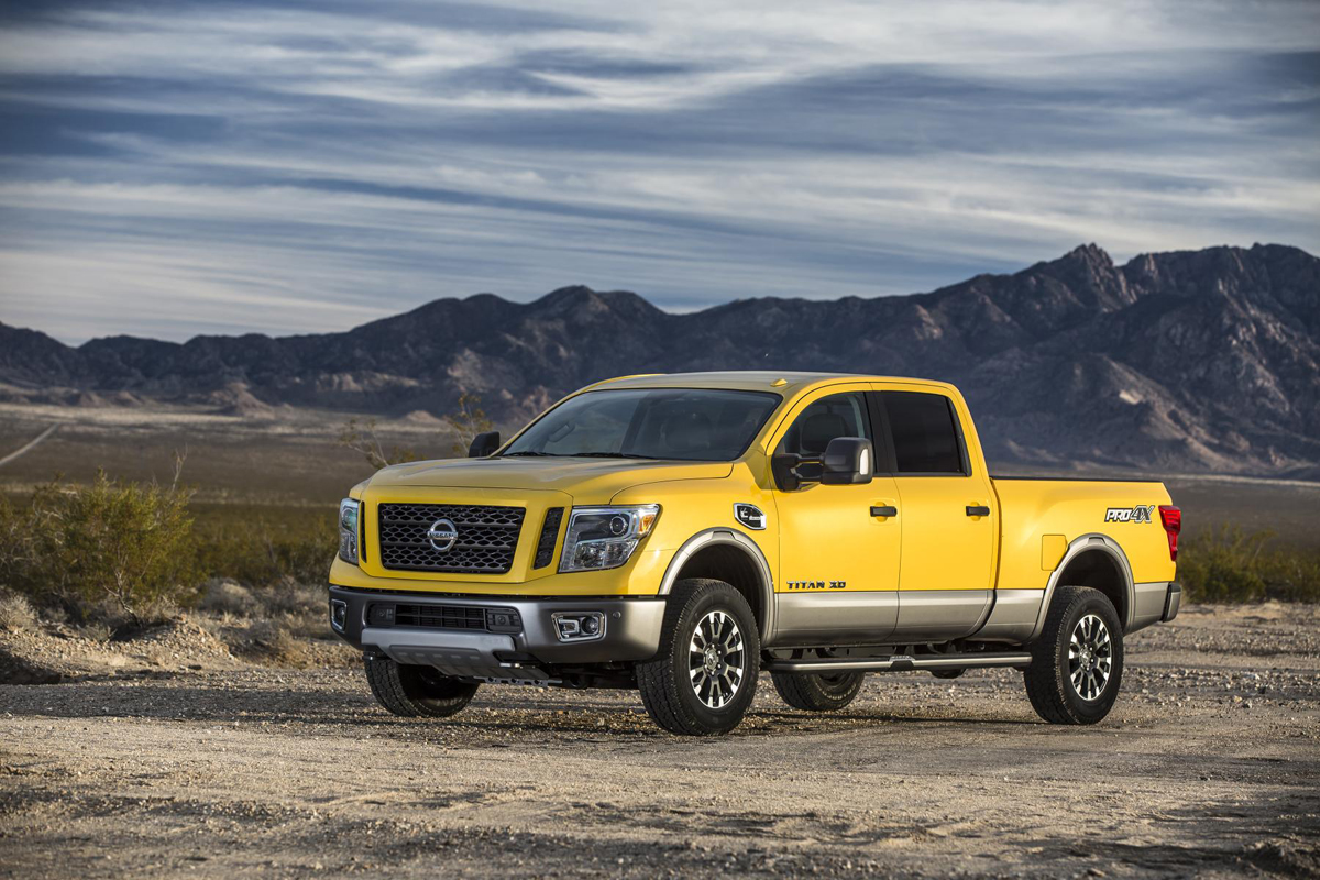 The Nissan Titan XD with Off Road Rims and Tires Rolls ...