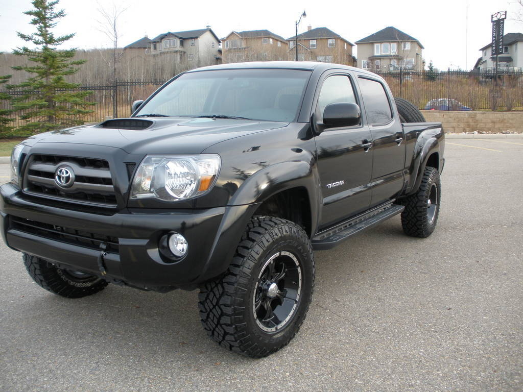 Doin Work With A Toyota Tacoma And Helo Wheels