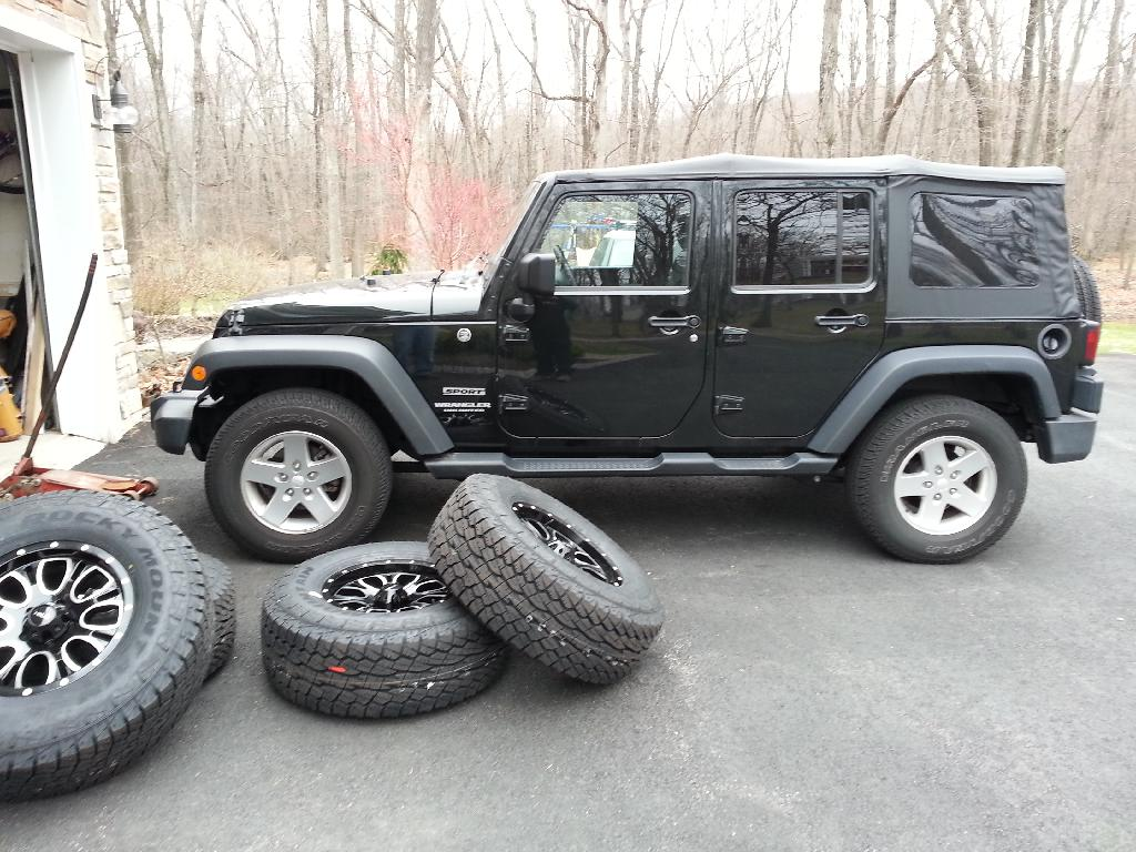 The Jeep Wrangler with Helo Wheels and Tires is a Boxy Beauty